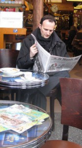Newspaper reader in Paris cafe
